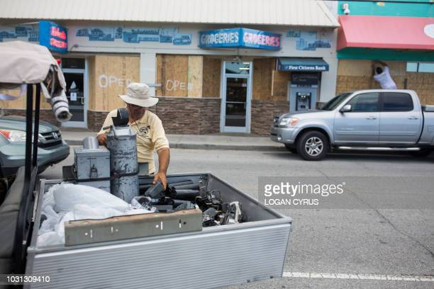 Mary Burdwood, an employee of the Wrightsville Beach Parking office removes the electronic parts of the parking meters on North Lumina Avenue in...
