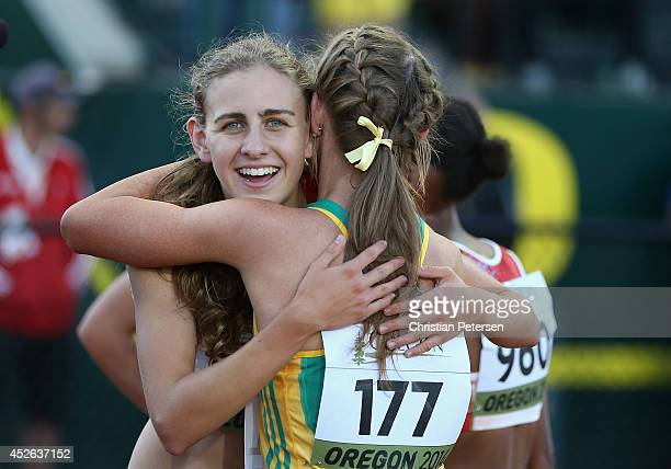 Mary Cain of the US hugs Jessica Hull of Australia after winning the women's 3000m final during day three of the IAAF World Junior Championships at...