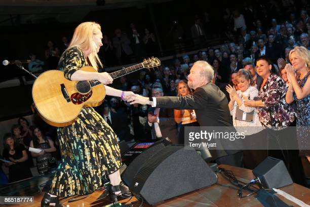 Mary Chapin Carpenter shares a moment with songwriter Don Schlitz onstage at the Country Music Hall of Fame and Museum Medallion Ceremony to...
