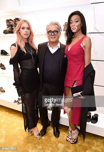 Mary Charteris Giuseppe Zanotti and Winnie Harlow attend the Giuseppe Zanotti London flagship store launch on October 26 2016 in London England