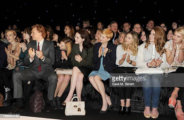 Mary Charteris Leith Clark Tom Hiddleston Laura Carmichael Michelle Dockery Michelle Williams Elizabeth Olsen Lana Del Rey and Pixie Geldof sit in...