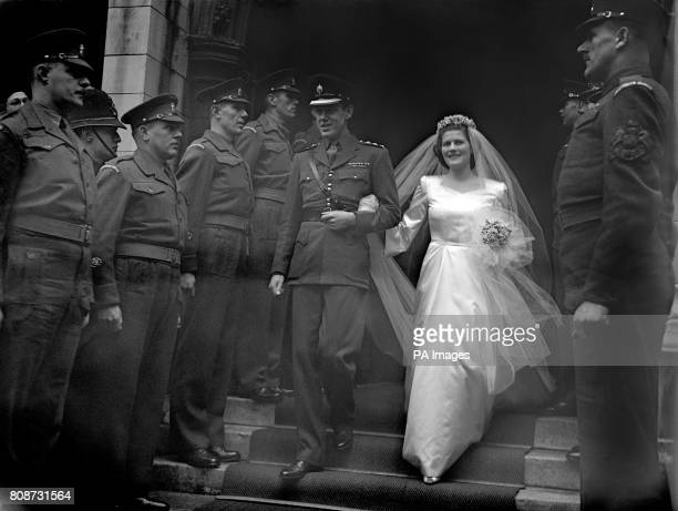 Mary Churchill youngest daughter of Winston Churchill after her wedding to Captain Christopher Soames at St Margaret's Church Westminster flanked by...