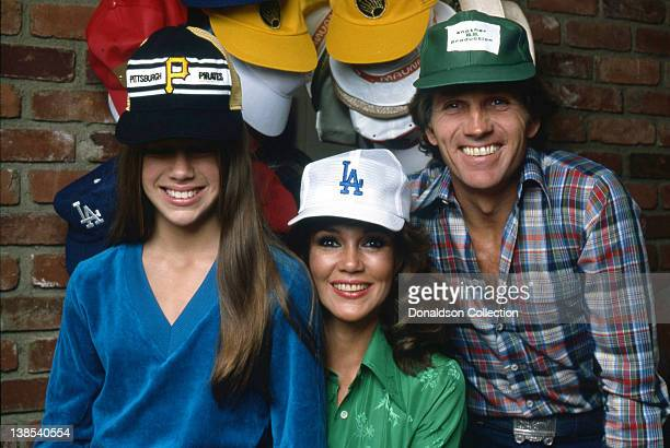 Mary Clancy Collins and her parents Actress Mary Ann Mobley and actor Gary Collins pose for a portrait wearing baseball caps in their home in circa...