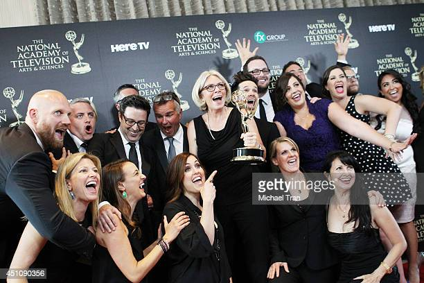 Mary Connelly and the crew of 'The Ellen DeGeneres Show' pose in the press room with the award for Outstanding Talk Show Entertainment at the 41st...