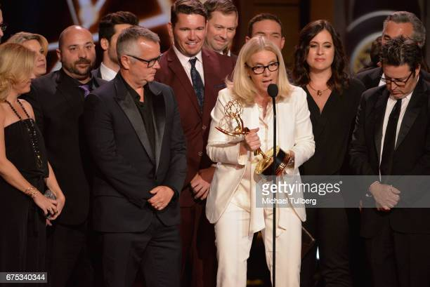 """Mary Connelly, center, accepts the award for outstanding entertainment talk show for """"The Ellen DeGeneres Show"""" at the 44th annual Daytime Emmy..."""