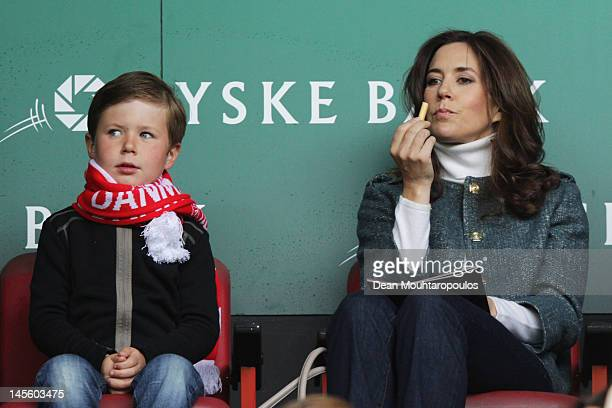 Mary Crown Princess of Denmark and her son Prince Christian Valdemar Henri John get ready to watch the International Friendly between Denmark and...