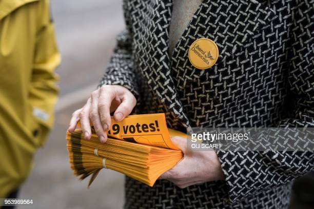 Mary D'Albert a Liberal Democrats councillor prepares to distribute campaign literature to local residents ahead of tomorrow's local elections in...