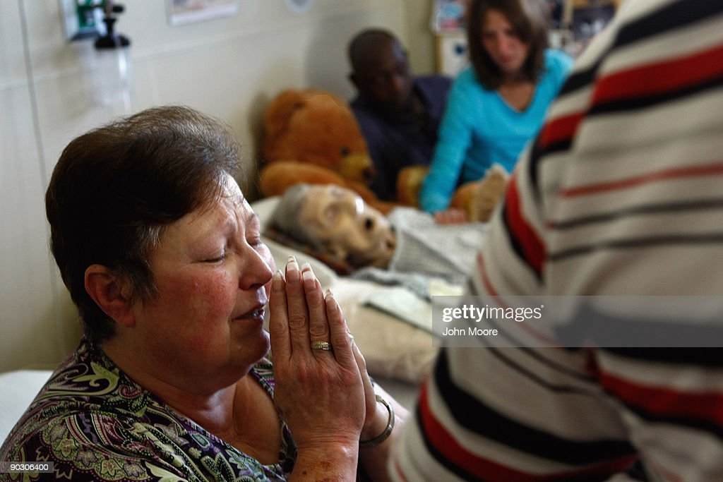 Mary Dardano prays next to the bed of her mother Annabelle Martin, 92, who had just passed away at the Hospice of Saint John on September 2, 2009 in Lakewood, Colorado. Martin had spent almost two and a half years living at the non-profit hospice, which strives to maintain quality of life, manage pain, and offer spirutal guidance for residents in their last stage of life. Government funding for counseling for end of life care has become a contentious issue in the current national debate on health care reform.