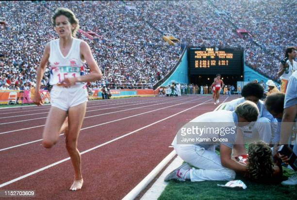 Mary Decker is attended to on track as Zola Budd went on to finish seventh in the women's 3000-meter race final during the 1984 Olympics at the...