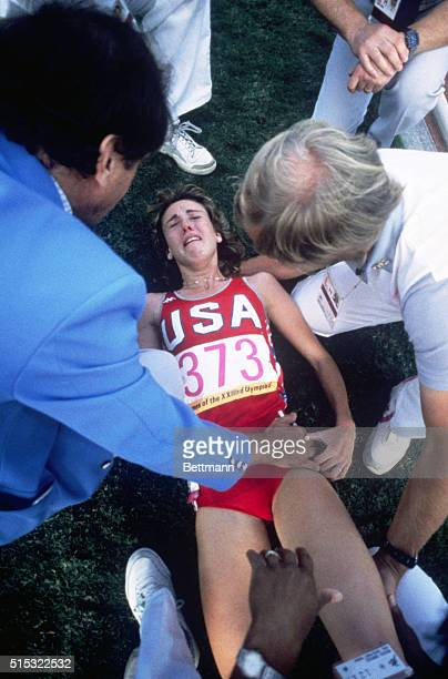 Mary Decker is helped beside the track after being crowded by Zola Budd and injured during the women's 3000 meter final in the Coliseum