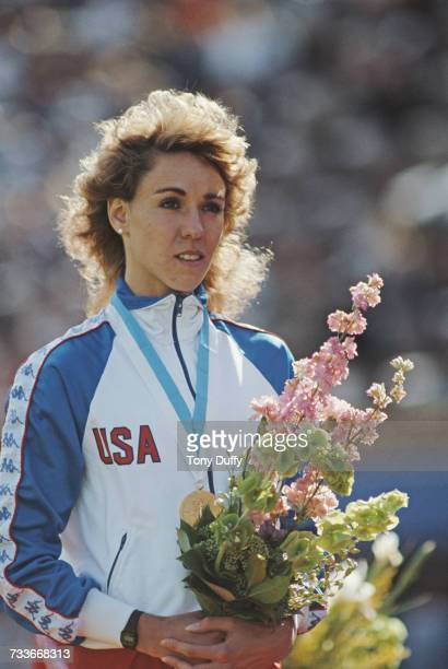 Mary Decker of the United States stands on the podium after receiving her gold medal for winning the Women's 1500 metres event at the IAAF World...
