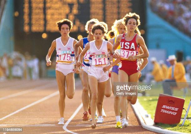 Mary Decker of the United States, Zola Budd of Great Britain running bare footed and Wendy Sly of Great Britain compete in the final of the Women's...