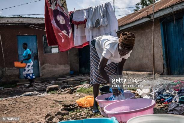 TOPSHOT Mary does her family's laundry on August 5 2017 in Obunga slum in the lakeside city of Kisumu one of the hotspots during the 20072008...