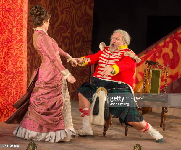 Mary Dunleavy as Alice Ford and Henry Waddington as Falstaff perform on stage during a performance of Verdi's opera 'Falstaff' at Garsington Opera at...
