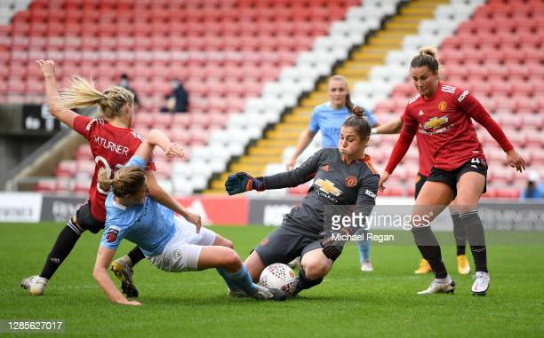 Mary Earps of Manchester United saves from Ellen White of Manchester City as she is challenged by Millie Turner of Manchester United during the...