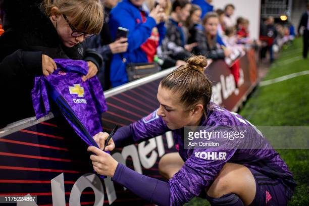 Mary Earps of Manchester United Women signs autographs for fans after the Barclays FA Women's Super League match between Manchester United and...