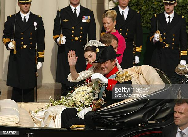 Mary Elisabeth Donaldson and Crown Prince Frederik of Denmark leave the Cathedral in Copenhagen 14 May 2004 after their wedding AFP PHOTO SVEN...