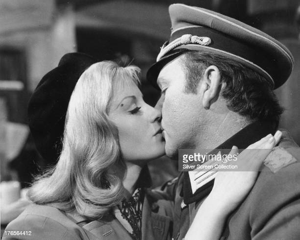 Mary Elison, played by Mary Ure , kisses Major Jonathan Smith, played by Richard Burton in 'Where Eagles Dare', directed by Brian G. Hutton, 1968.