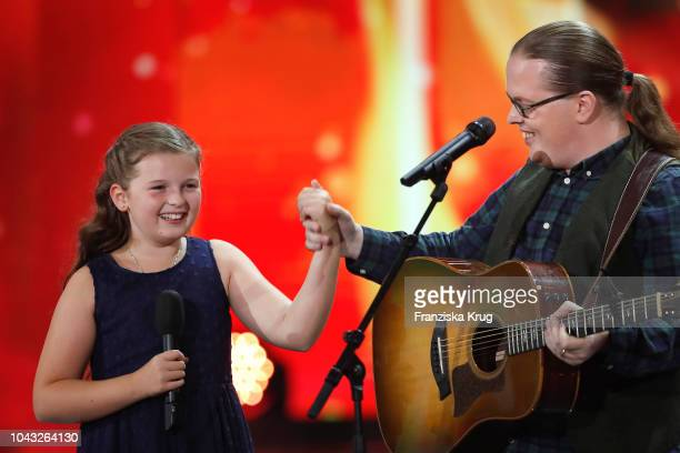 Mary Emma Kelly and her father Angelo Kelly perform during the television show 'Willkommen bei Carmen Nebel' at Velodrom on September 29 2018 in...