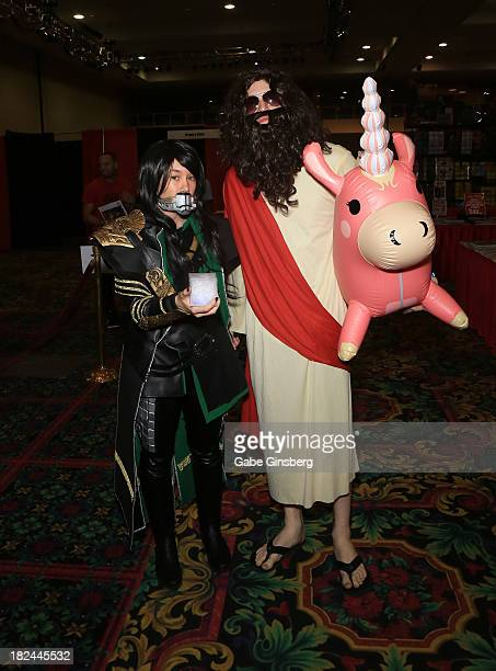 """Mary Ernst dressed as Loki from the """"Thor"""" movie franchise and Brett Eaves dressed as Jesus Christ attend the Las Vegas Comic Expo at the Riviera..."""