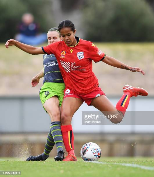 Mary Fowler of Adelaide United shoots for goal defended by Olivia Price of Canberra United during the round six W-League match between Adelaide...