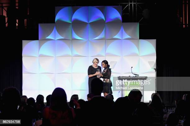 Mary Gen Ledecky accepts the Individual Sportswoman of the YearAward for daughter Katie Ledecky from Gabby Douglas during The Women's Sports...