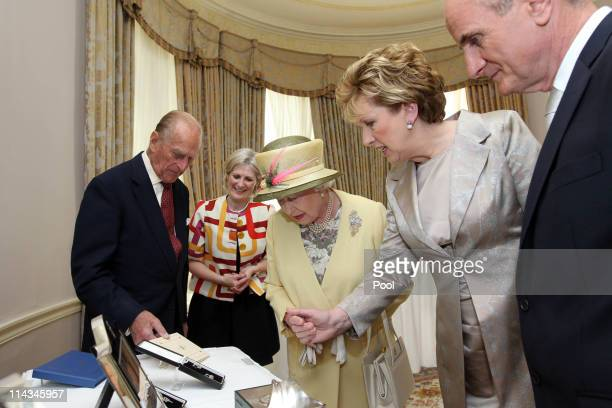 Mary Heffernan, General Manager of National Historic Properties, President Mary McAleese and Dr. Martin McAleese present Queen Elizabeth II and...