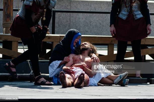 Mary holds body of Jesus after his death on the cross during a Good Friday performance of 'The Passion of Jesus' by Wintershall cast in Trafalgar...