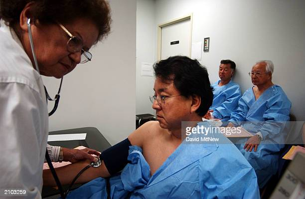 Mary Isa records the blood pressure of Glenn Yamada whose mother survived the explosion of an atomic bomb over Hiroshima Japan by the United States...