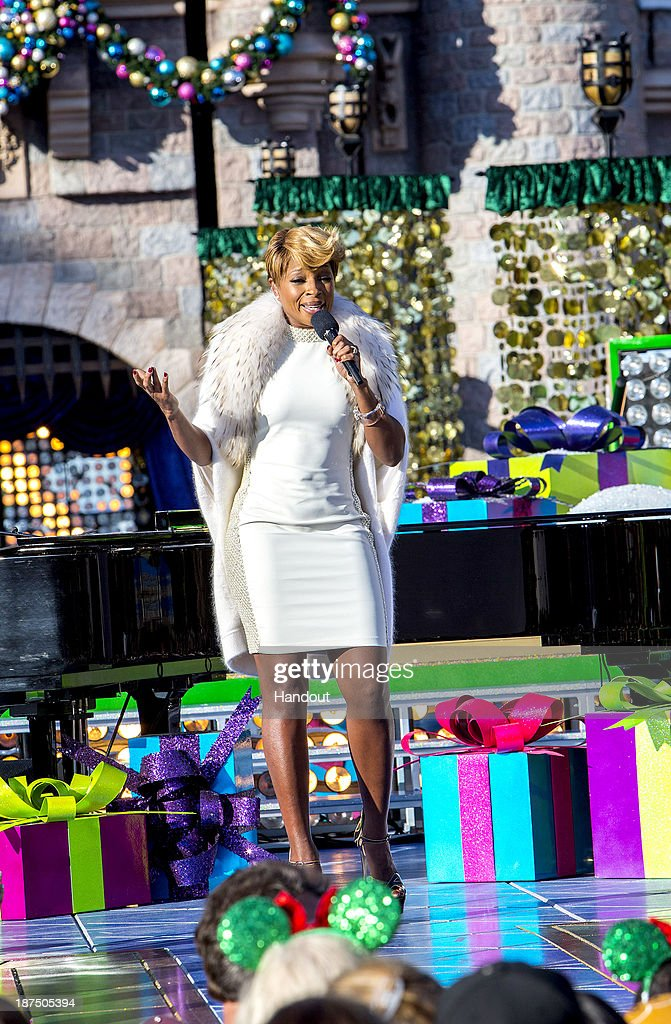 Mary J. Blige, accompanied by David Foster, performs 'Have Yourself a Merry Little Christmas' during a taping for the 'Disney Parks Christmas Day Parade' television special at Disneyland on November 9, 2013 in Anahiem, California. 'Disney Parks Christmas Day Parade' airs December 25 on ABC.