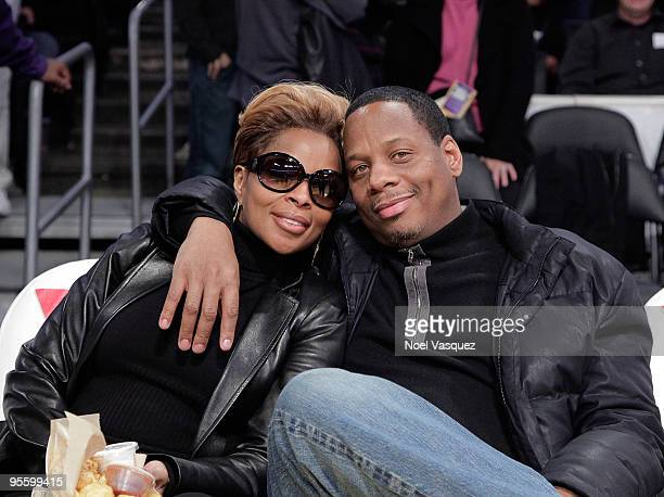 Mary J Blige and her husband Martin Kendu Isaacs attend a game between the Houston Rockets and the Los Angeles Lakers at Staples Center on January 5...