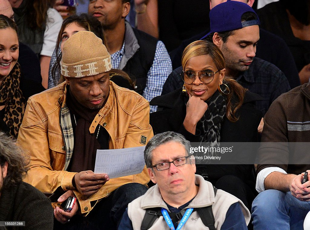 Mary J. Blige and husband Kendu Isaacs (L) attend the Miami Heat vs New York Knicks game at Madison Square Garden on November 2, 2012 in New York City.