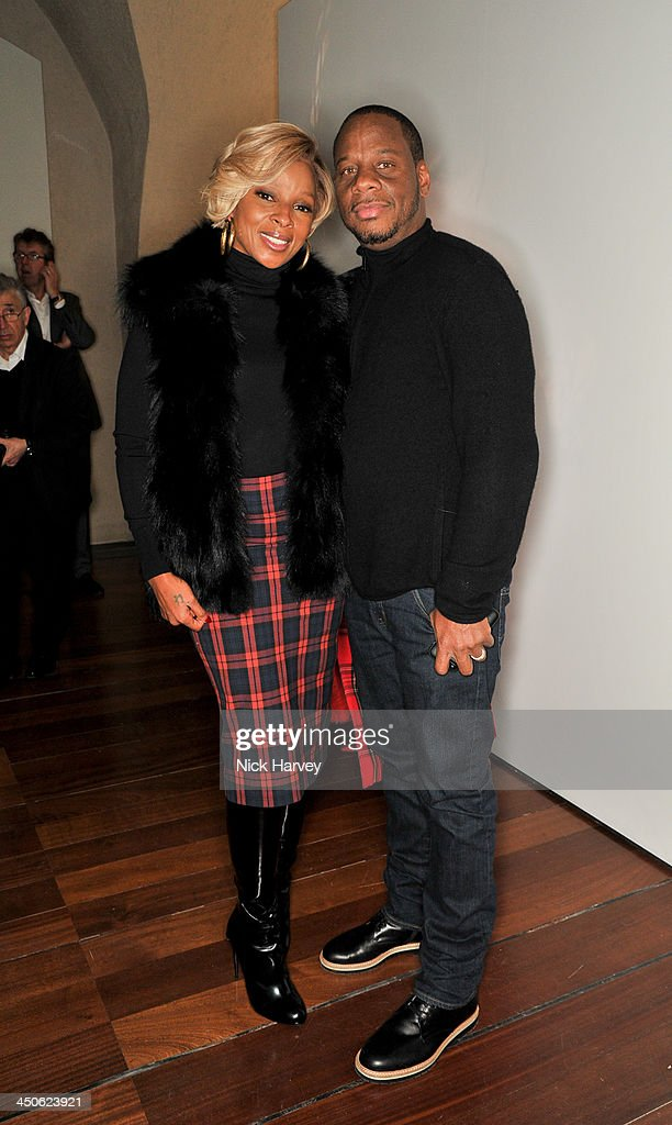 Mary J. Blige and Kendu Isaacs attend the private view of Isabella Blow: Fashion Galore! Party at Somerset House on November 19, 2013 in London, England.