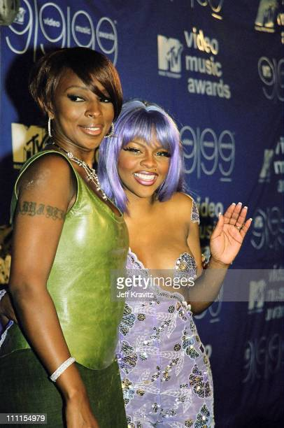 Mary J Blige and Lil' Kim during 1999 MTV VMA's Press Room at Lincoln Center in New York City New York United States