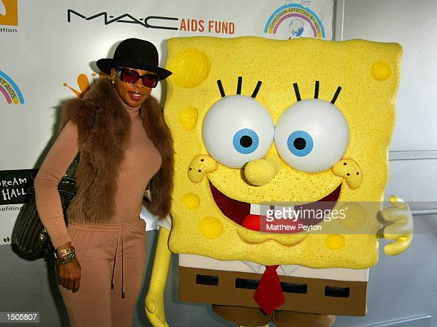 Mary J Blige and Nickelodeon character SpongeBob SquarePants attend New York's Greatest Dream Halloween Event at Chelsea Piers October 20 2002 in New...