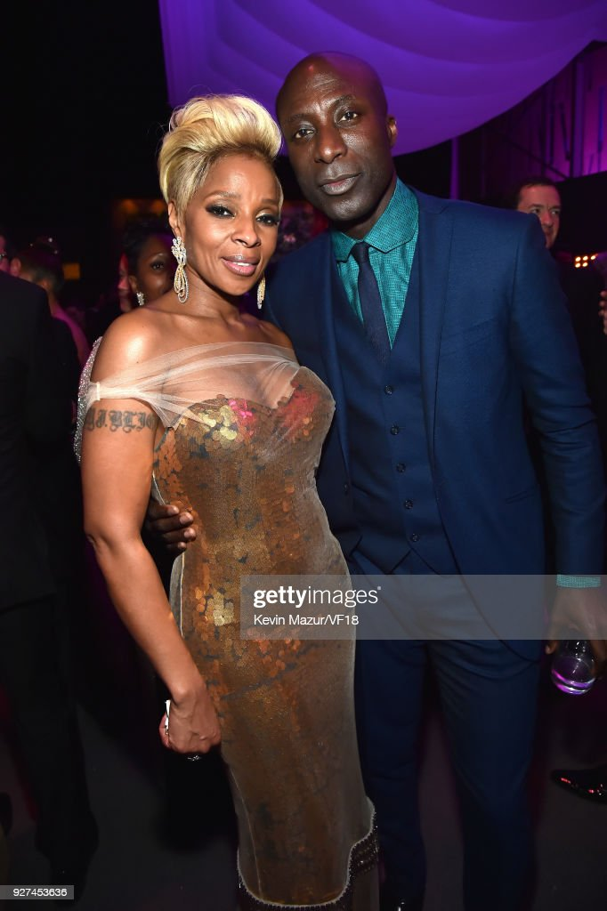 Mary J. Blige (L) and Ozwald Boateng attend the 2018 Vanity Fair Oscar Party hosted by Radhika Jones at Wallis Annenberg Center for the Performing Arts on March 4, 2018 in Beverly Hills, California.