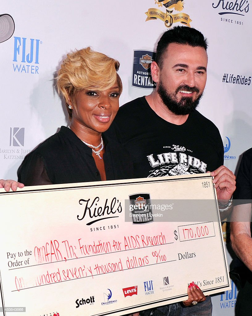 Mary J. Blige (L) and President, Kiehl's USA Chris Salgardo attend Kiehl's LifeRide for amfAR co-hosted by FIJI Water on August 12, 2014 in New York City.