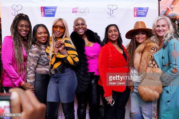 Mary J Blige and Simone I Smith pose onstage with ACS cancer survivors as they launch their Sister Love Jewelry Holiday Pop Up Shop In Long Island...