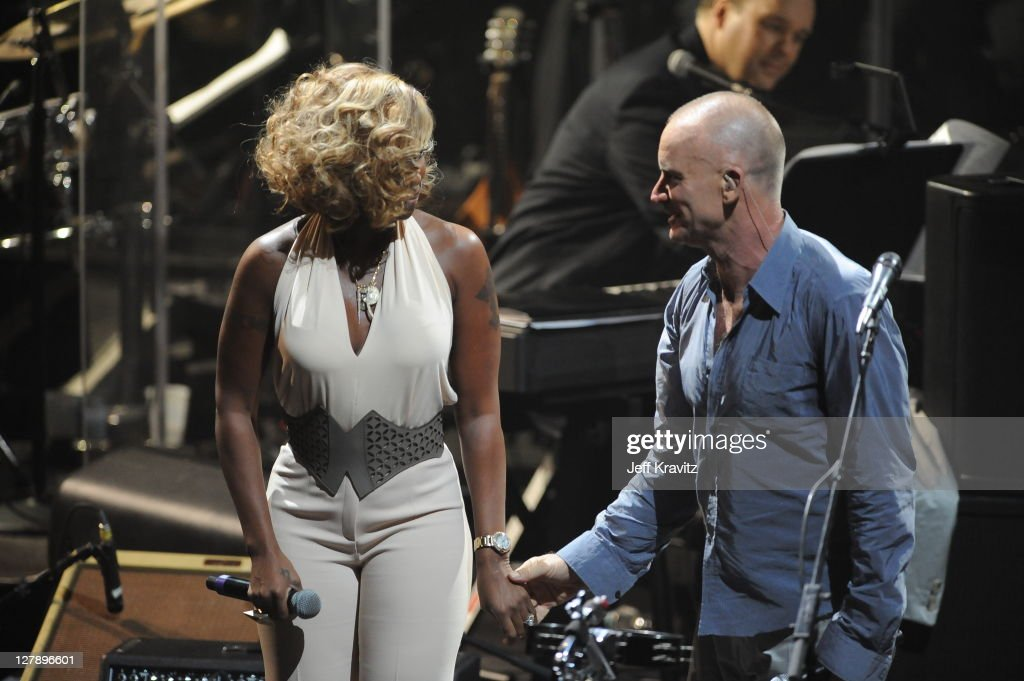 Mary J Blige and Sting perform on stage during