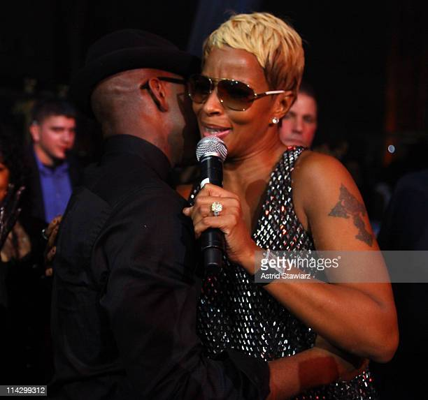 Mary J Blige is embraced by NeYo during his 30th Birthday Bash 'Cold As Ice' at Cipriani 42nd Street on October 17 2009 in New York City