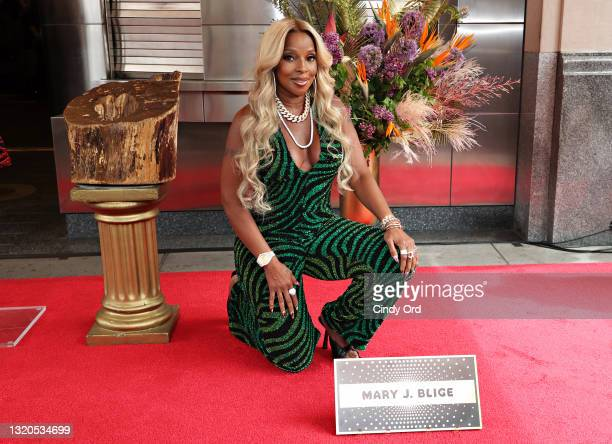 Mary J. Blige is inducted to The Apollo walk of fame at The Apollo Theater on May 28, 2021 in New York City.