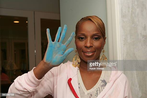 Mary J Blige makes her blue handprint in the official book as she records her contribution to the new disaster relief charity single a cover of the...