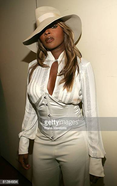 Mary J Blige poses backstage at the Fashion Rocks concert held at Radio City Music Hall on September 8 2004 in New York City Blige wears a pants suit...