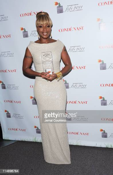 Mary J Blige poses with her award backstage at the 2011 FiFi Awards at The Tent at Lincoln Center on May 25 2011 in New York City