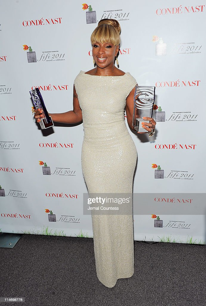 Mary J. Blige poses with her awards backstage at the 2011 FiFi Awards at The Tent at Lincoln Center on May 25, 2011 in New York City.