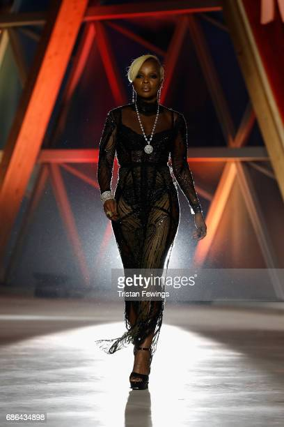 Mary J Blige walks the runway at the Fashion for Relief event during the 70th annual Cannes Film Festival at Aeroport Cannes Mandelieu on May 21 2017...