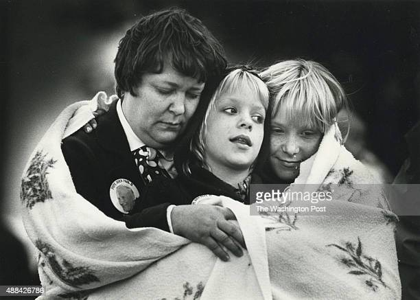 Mary Jane Fanning and her two daughters Mary and Elizabeth during a Mass at the National Mall celebrated by the Pope John Paul II during his trip to...
