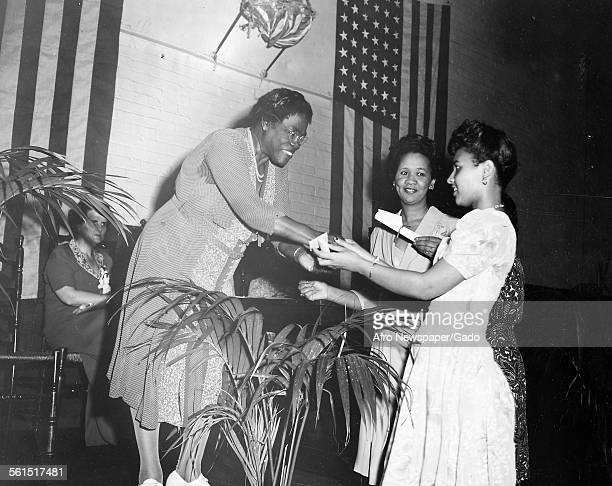 Mary Jane McLeod Bethune an American educator and civil rights leader giving achievement prizes to young students Washington DC 1939