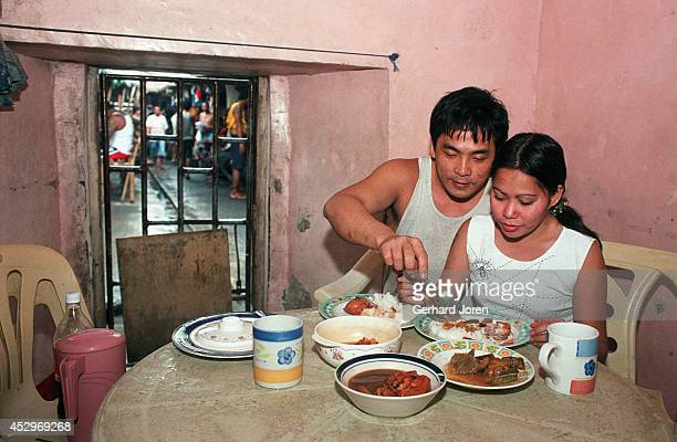 Mary Jane Palima and her boyfriend Anthony Chiu, 32 during lunch in their VIP cell at the Sputnik gang barrack at the Manila City Jail. Sputnik is...