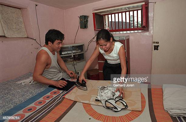 Mary Jane Palima and her boyfriend Anthony Chiu iron their laundry in their VIP cell at the Sputnik gang barrack at the Manila City Jail. Sputnik is...